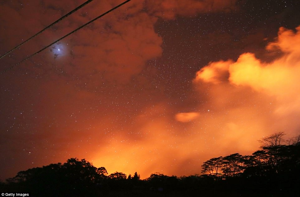 Lava from active fissures illuminates volcanic gases from the Kilauea volcano on Wednesday night prior to the volcano erupting