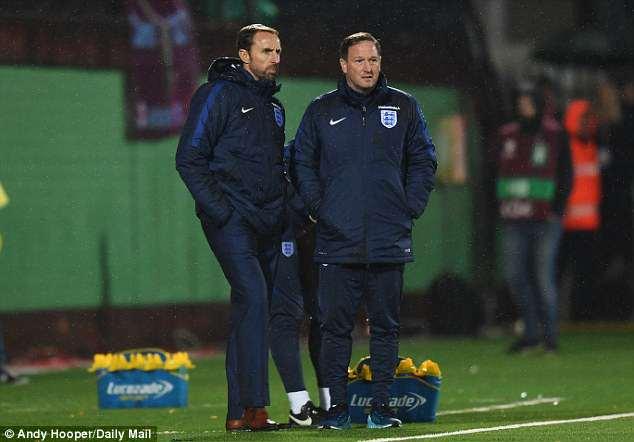 England assistant coach Steve Holland (right) was photographed alongside Dario Gradi