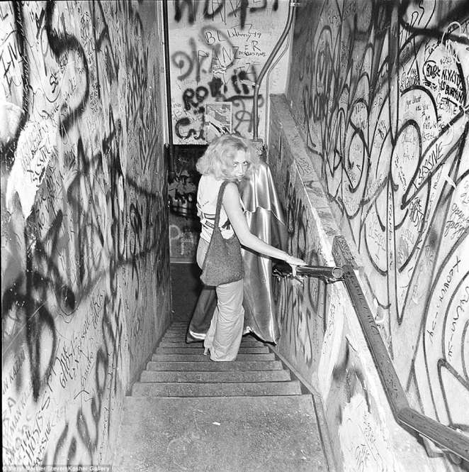 Meisler's images of the iconic bar show a glimpse into how the CBGB played a critical role into music history. Pictured above is a woman walking down the stairway inside CBGB