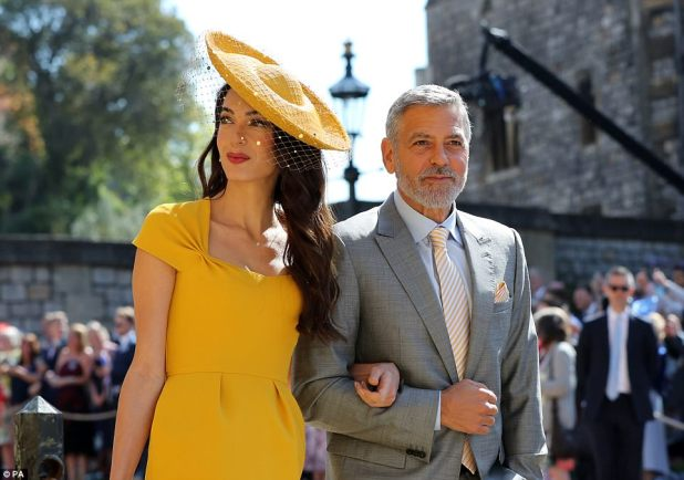 Tinseltown's finest: Hollywood legend George Clooney paid tribute to his wife's yellow gown with an accented tie and handkerchief