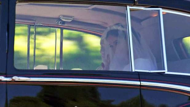 Her mother Doria smiled and looked adoringly at her daughter in the back of her wedding car, again supporting her in the absence of her father Thomas Markle