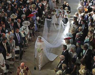 Meghan Markle stuns in pure white silk Givenchy gown and 15ft veil