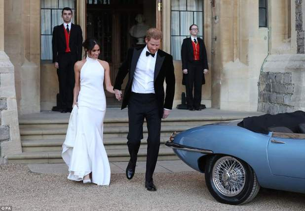 Meghanis wearing shoes from Aquazurra made in silky satin, with nude mesh, with soles painted in baby blue