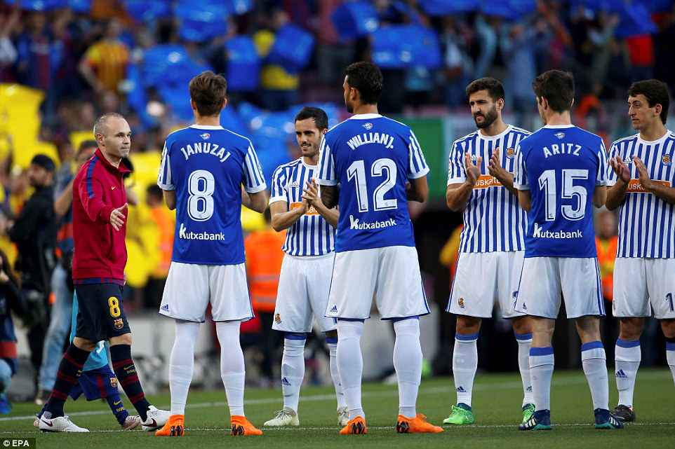 Real Sociedad players pay tribute to Andres Iniesta (left) with a guard of honour prior to Sunday night's game