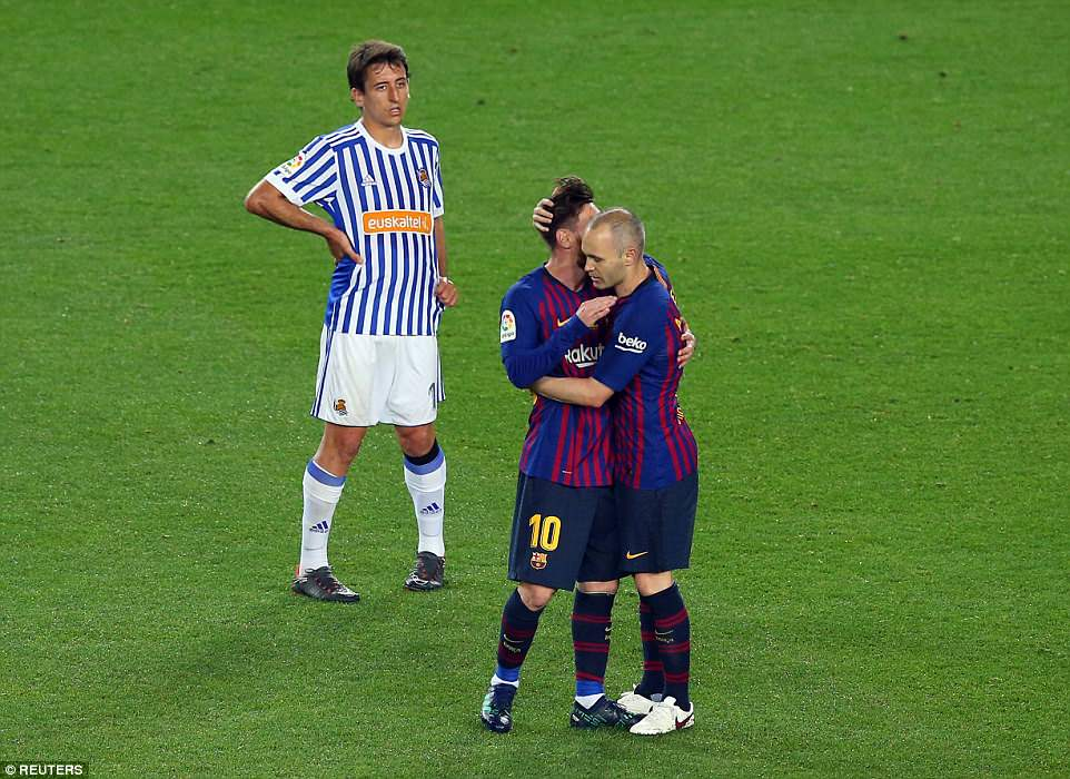 Iniesta (right) hugs team-mate Lionel Messi (left) after being substituted in the closing stages of the La Liga clash