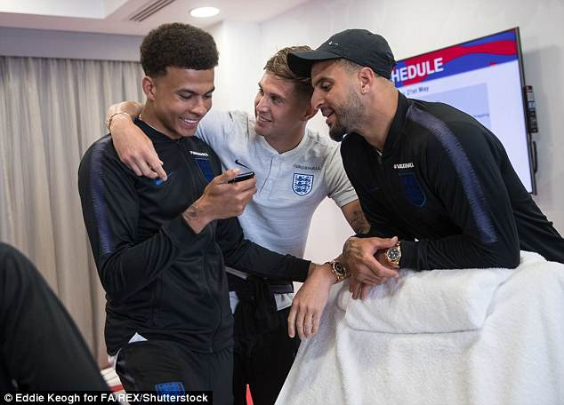 Dele Alli, John Stones and Kyle Walker enjoy a light-hearted moment at the training camp