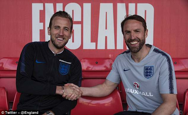 Kane and Gareth Southgate shake hands at St George's Park ahead of an open training session