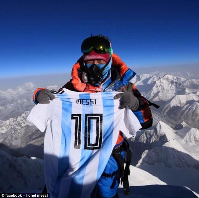 ClimberDan Zengluobu showed off a Lionel Messi shirt after reaching the top of Mount Everest