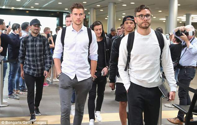 The Germany squad arrive in very relaxed attire as fans welcome them at the airport