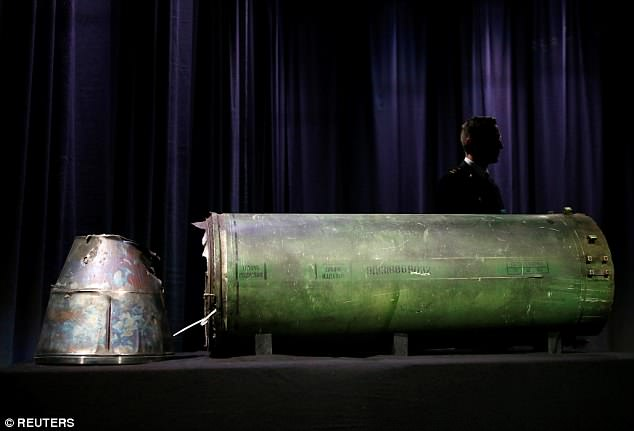Russian projectile: The damaged Russian missile that shot down flight MH17, killing all 298 people on board, is put on display inBunnik, Netherlands, today