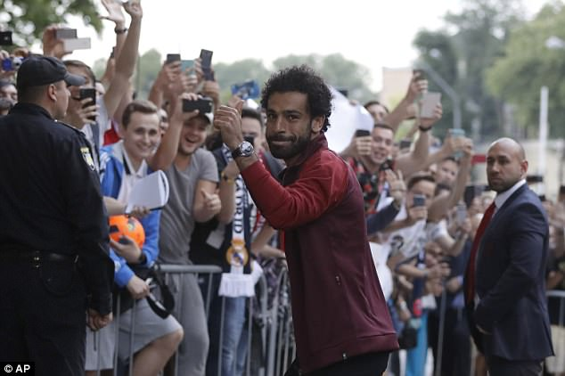 Mohamed Salah is greeted by hundreds of fans after arriving at the Liverpool hotel in Kiev