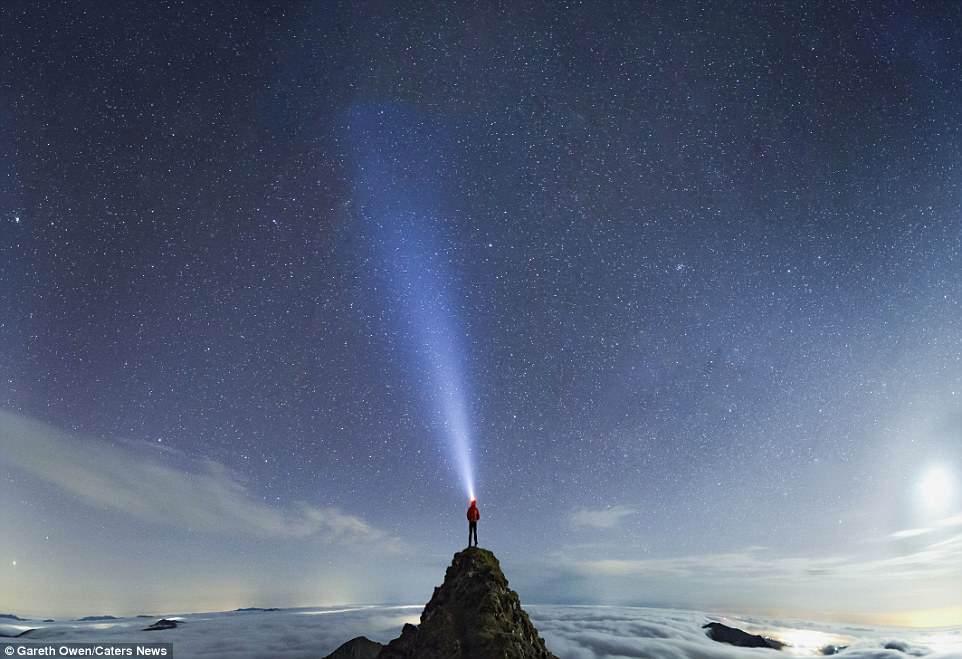 Photographer Gareth Owen, who captures epic selfies around Wales. Gareth is pictured on the Rhydd Ddu peak in Snowdon