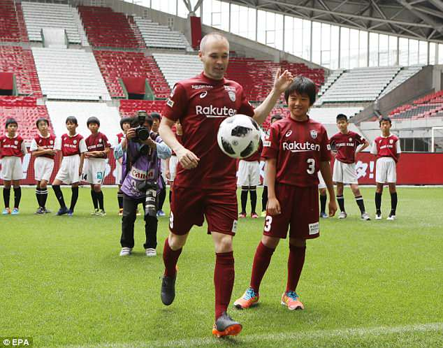 After juggling the ball with ease, Iniesta kicked footballs into the stand full of supporters