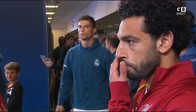 Cristiano Ronaldo stares towards Mohamed Salah before the Champions League final