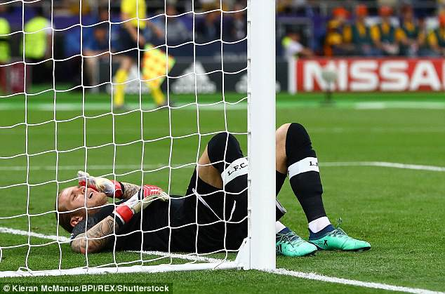 Karius lay on the ground after misjudging Gareth Bale's second goal of the night weakly palming the ball into his own net