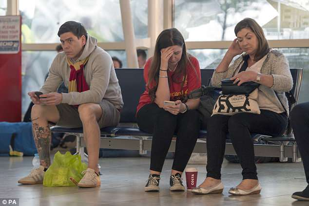 Distraught Liverpool fans begin to arrive home at John Lennon Airport