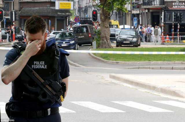 Emotions: A male police officer is seen breaking down at the scene where two colleagues were shot by an attacker who had allegedly been released from prison the day before