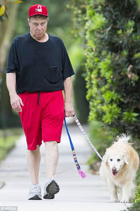 Soon after the news broke, Goodman, who played Barr's husband Dan on the TV show, was spotted looking very glum as he walked his dog