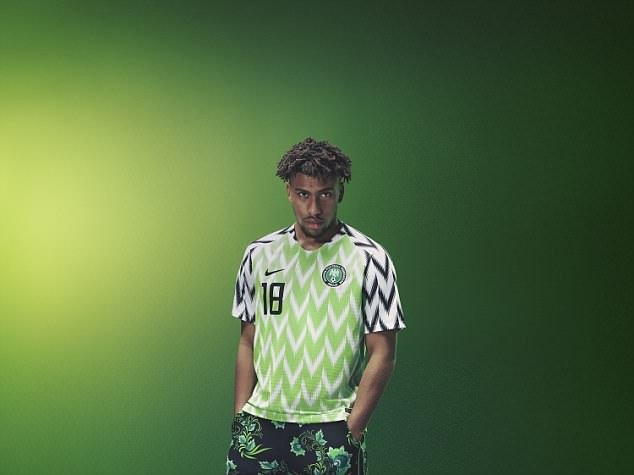 Alex Iwobi poses in Nigeria's new Nike kit as they release the collection for sale in England