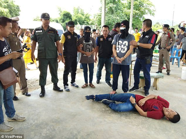 The four men who allegedly confessed to raping Nong Gift are taken on a police re-enactment