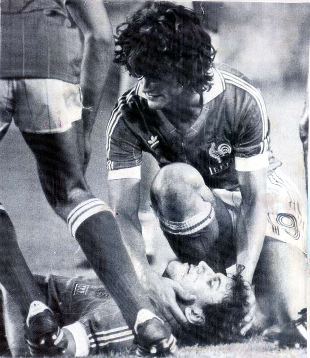 Patrick Battiston lies on the ground after being knocked out cold byHarald Schumacher