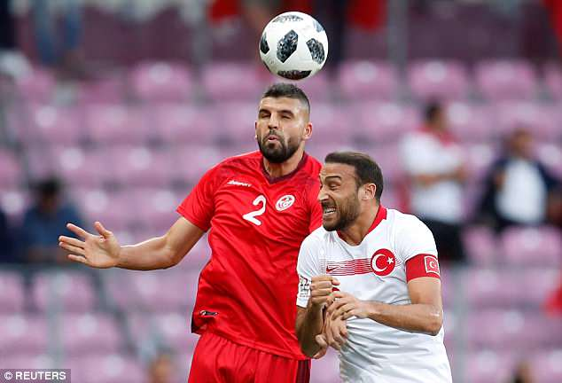 Everton striker Tosun battles for the ball in the air with Tunisia's Syam Ben Youssef