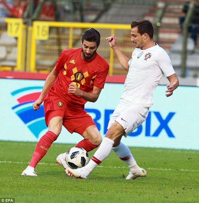 Yannick Carrasco looks to outsmart Portugal defender Cedric Soares with a fake