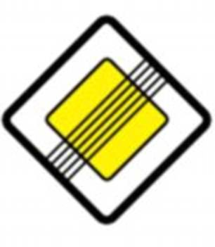 A road sign that features a white diamond shape with a yellow diamond inside