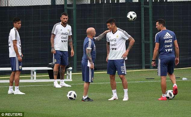 Nicolas Otamendi (2-L) trains with fellow defenders including Man United's Marcos Rojo (2-R)