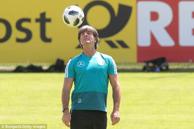 The Germany boss proves he can play as well as manage as he coolly keeps the ball aloft