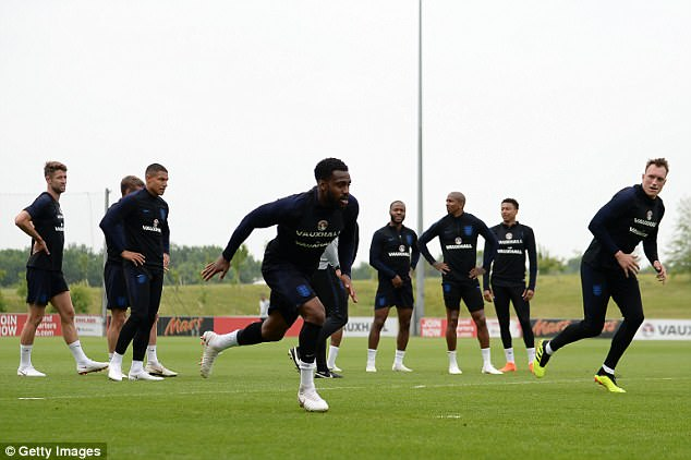 Danny Rose, pictured (centre) in England training, has told his family not to go to Russia 2018
