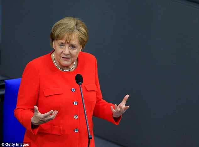 Angela Merkel was accused of 'importing Islamists, rapists, murderers and terrorists' as she was questioned by nationalist opposition in the German parliament for the first time