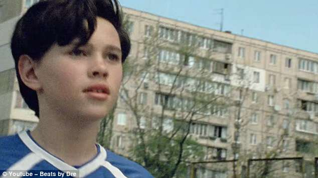 The motivational advert begins  in Russia and focuses on a young boy playing football in a park