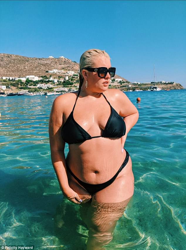 The blonde bombshell (pictured during her holiday in Santorini) was originally approached by a model scout when she was in the pub