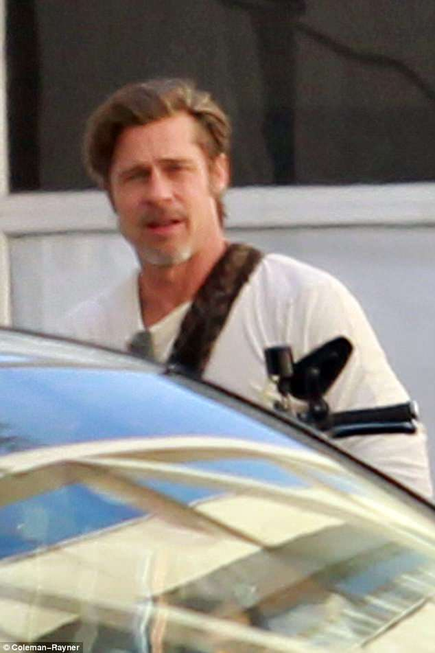 Excited: Brad smiled broadly as he arrived to meet his co-stars