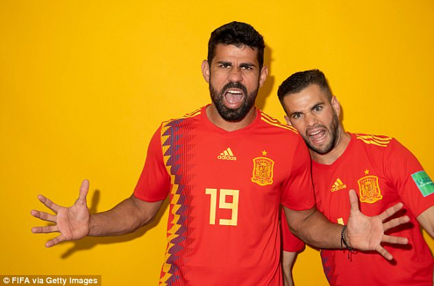 Striker Diego Costa (centre) stretches both arms out wide as he andNacho Fernandez gurn