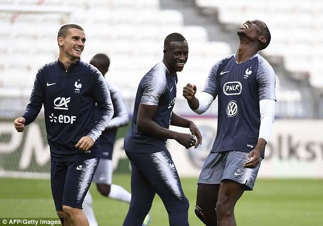 Antoine Griezmann (left), Benjamin Mendy (centre) and Paul Pogba (right) joke around in Lyon