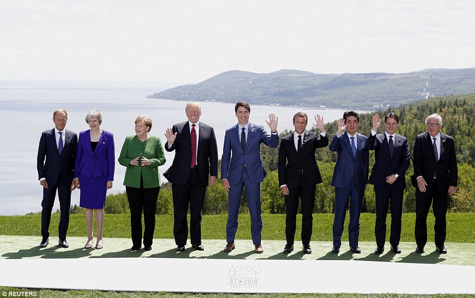 Family time: European Council President Donald Tusk, British Prime Minister Theresa May, German Chancellor Angela Merkel, U.S. President Donald Trump, Canadian Prime Minister Justin Trudeau, French President Emmanuel Macron, Japanese Prime Minister Shinzo Abe, Italian Prime Minister Giuseppe Conte and European Commission President Jean-Claude Juncker pose at the start of the G7 in La Malbaie, Charlevoix, Quebec