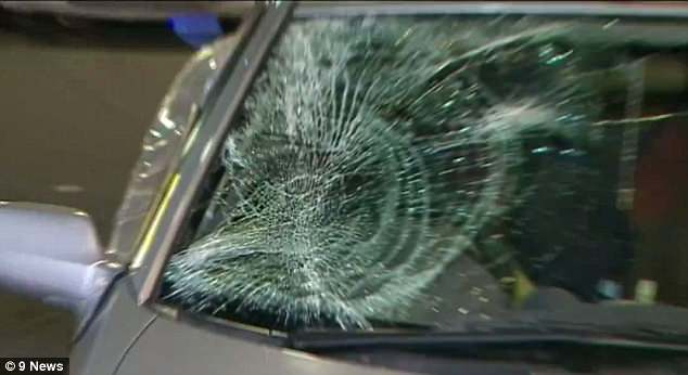 The car's windscreen was shattered (pictured) after a woman supposedly stepped out from the sidewalk