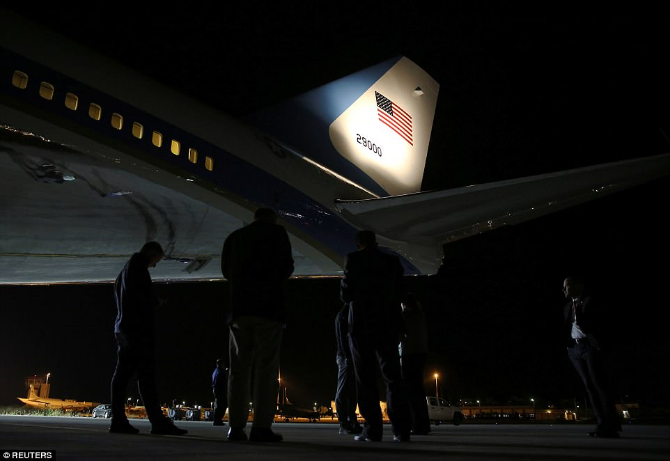 Journalists and White House staff stand under Air Force One, as it is stopped on Sunday for a refuel in Chania, Greece while carrying Trump from Canada to Singapore for an anticipated summit with North Korea's leader Kim Jong Un