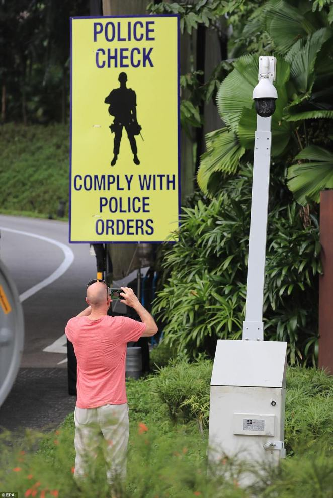 A sign for a police checkpoint is newly set up in front of the Capella Hotel in Singapore, where Trump and Kim will meet