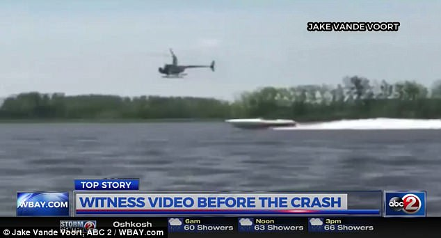 The helicopter, above, was filmed speeding above a boat just 30 minutes before the crash