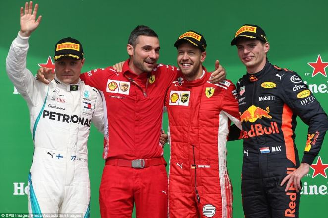Vettel took victory ahead of Mercedes' Valtteri Bottas (left) and Red Bull's Max Verstappen as they celebrate on the podium