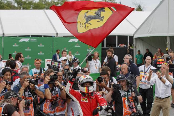 Vettel waves the Ferrari flag 40 years on since Gilles Villeneuve claimed his first win driving for the team in Canada