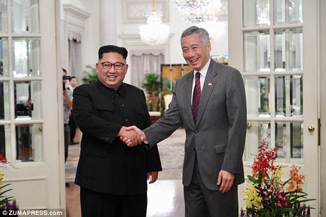 North Korean ruler Kim (left) is seen in Singapore on Sunday with Singapore Prime Minister Lee Hsien Loong