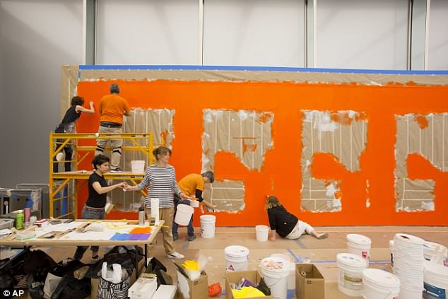 Artists in the lobby of 3 World trade work to create a wall drawing for the building's opening on Monday
