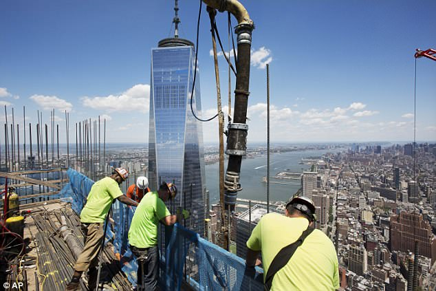 In June 2016, workers poured concrete on the top floor of 3 World Trade Center, the 104-story One World Trade is in the background