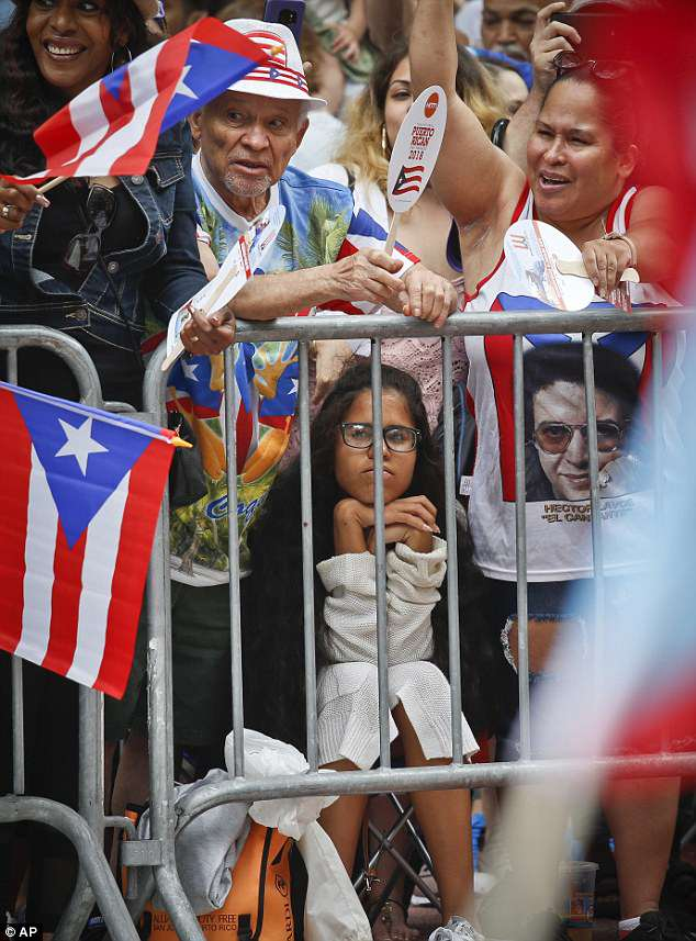Crowds watched marchers in the annual Puerto Rican Day parade as they moved up Fifth Avenue