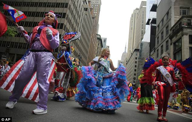 Costumed dancers, a tradition in the Puerto Rican Day Parade, make their way up Fifth Avenue