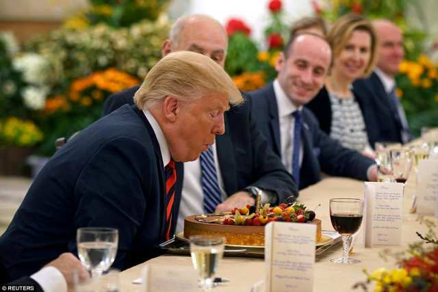 Donald Trump arrived in Singapore on Monday ahead of his meeting with North Korea dictator Kim Jong Un and was presented with an early 72nd birthday cake by Singapore's Prime MinisterLee Hsien Loong